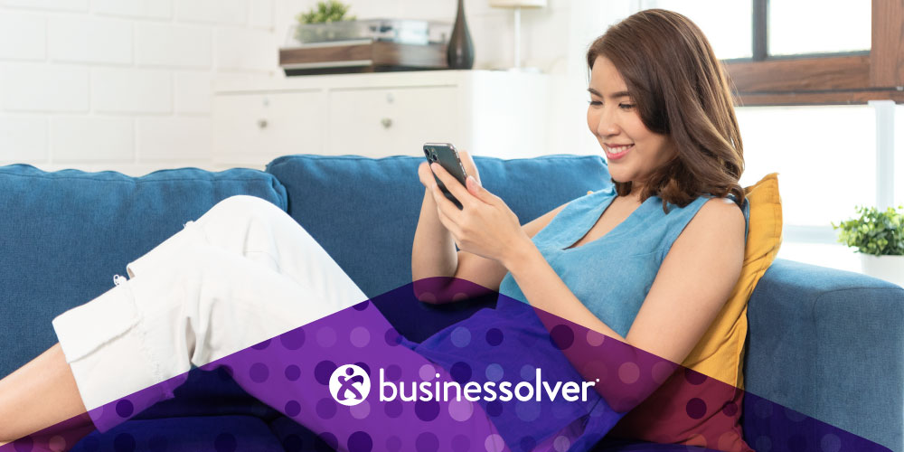 woman-on-the-couch-looking-at-iphone